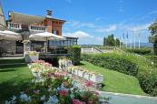 Relax inside or out of the Clubhouse after your game at the Garda Golf Country Club, Italy