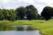 17th hole with lake features and green towards the hotel at Knightsbrook Golf Course