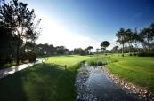 The 8th hole with challenging water feature at Montgomerie Maxx Royal Golf Club