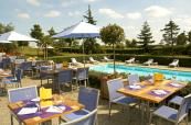 Terrasse with direct access to the swimming pool at Novotel Saint-Quentin Golf National