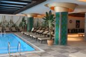 Indoor swimming pool loungers at Sueno Hotels Golf Belek