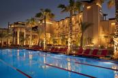 Hotel at night behind the outdoor pool at The Westin Abu Dhabi Golf Resort & Spa