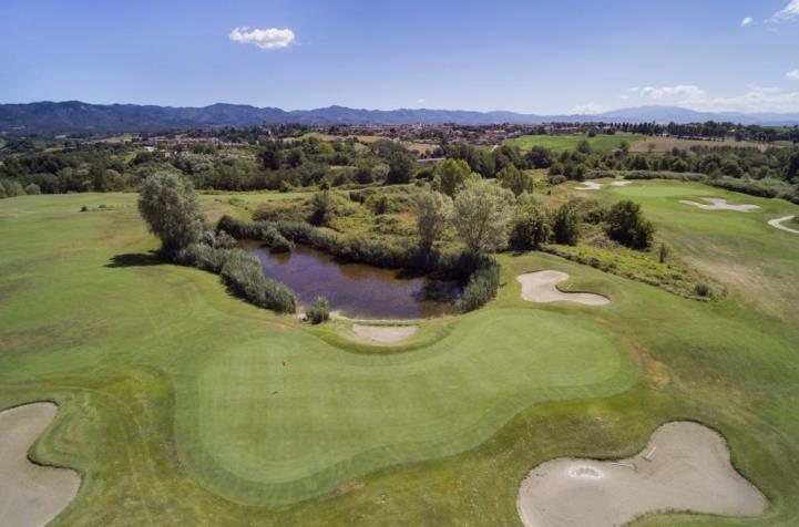 Aerial shot of the on site golf course at UNA Poggio Dei Medici Golf Resort